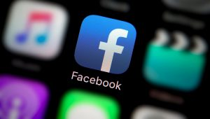A close-up shot of the company logo representing the Facebook app icon, as seen on the screen of a smart phone. | Alamy