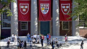Harvard banners hang outside Memorial Church on the Harvard University campus in Cambridge, Massachusetts. Photographer: Michael Fein