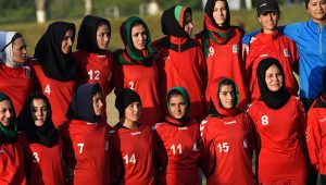 Afghanistan women's football team poses for a picture after practice during the SAFF Women's Championship in Islamabad, Pakistan; 2014 (x-post r/Afghanistan)