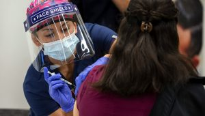 Registered Nurse Reanne Takara administers the Pfizer COVID-19 vaccine to frontline health workers at UC Davis Medical Center on Dec. 15, 2020. Photo courtesy of UC Davis Health