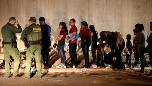 Migrants wait in line to seek asylum after illegally entering the United States in Hidalgo, Texas. Loren Elliott/Reuters