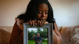 Rafiah Maxie sits for a portrait at her home on July 9, 2021, in Olympia Fields, Illinois. Maxie's son, Jamal Clay, died by suicide in May 2020. | Credit: Taylor Glascock for KHN