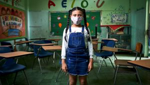 On 16 September 2020, a student stands in an empty classroom in Panama City. | The United Nations Children's Fund (Flickr)