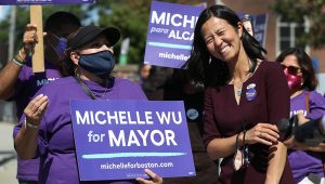 Mayoral candidate Michelle Wu shares a laugh with supporters outside a poling place on Election Day on September 14, 2021 in East Boston, MA. (Staff Photo By Nancy Lane/MediaNews Group/Boston Herald)