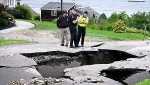 Fairview Lane in Portsmouth, R.I., was washed out in the floodings rains. MARK STOCKWELL FOR THE BOSTON GLOBE.