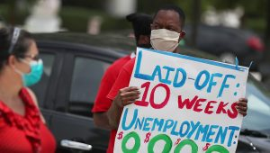 Florida resident Joseph Louis at a May 22 protest in Miami Beach asking the state to fix its unemployment system. | Joe Raedle | Getty Images