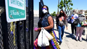 People enter the 88th Street Temple Church of God in Christ for an emergency food distribution on April 14, 2020 in Los Angeles. (Frederic J. Brown/AFP via Getty Images)