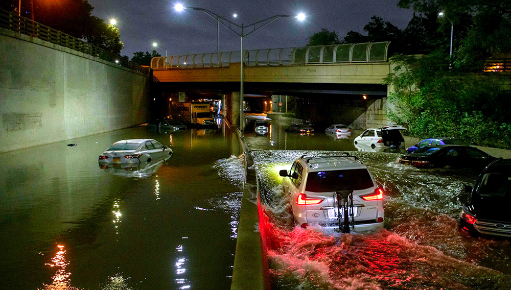 Floodwater surrounds vehicles after heavy rain on an expressway. | AFP/Getty Images