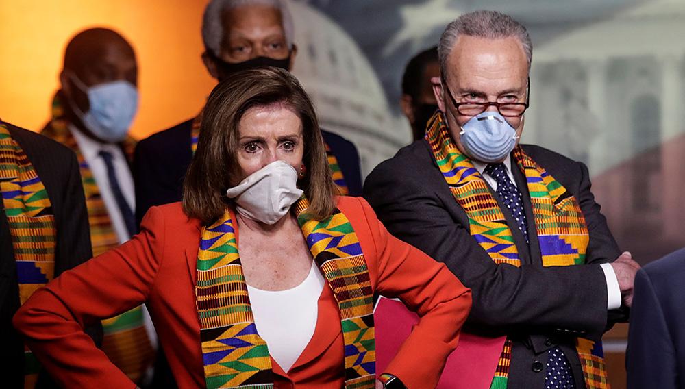 House Speaker Nancy Pelosi (D-Calif.) and Senate Minority Leader Charles E. Schumer (D-N.Y.). (Jonathan Ernst/Reuters)