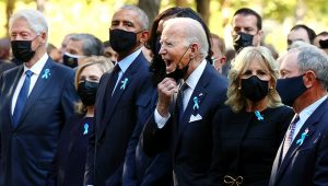 New York (United States), 11/09/2021.- President Joe Biden, center, calls out as he is joined by, from left, former President Bill Clinton, former First Lady Hillary Clinton, former President Barack Obama, former First Lady Michelle Obama, First Lady Jill Biden and former New York City Mayor Michael Bloomberg, during the annual 9/11 Commemoration Ceremony at the National 9/11 Memorial and Museum on Saturday, Sept. 11, 2021 in New York. (Chip Somodevilla/Pool Photo via AP)