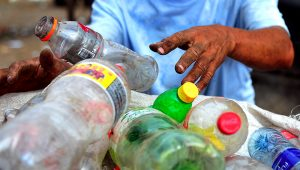 A man collects plastic bottles to sell for recycling, in a landfill of Managua, on January 11, 2013. | PHOTO: Hector Retamal/AFP/Getty Images