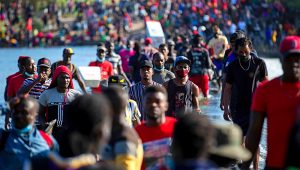 Haiti migrants waiting in Del Rio and Ciudad Acuna to get access to the United States, cross the Rio Grande toward Ciudad Acuma to get supplies, on Sept. 17, 2021, in Ciudad Acuna, Mexico. | Marie D. De Jesús / Houston Chronicle via AP
