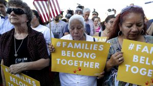 """Protesters in San Antonio pray during a Rally For Our Children event to protest the Trump administration's """"zero-tolerance"""" immigration policy. 