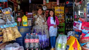 File photo of Lucia Mayta, 43, and her daughter Luz Cecilia, 12, posing for a photograph inside their bodega in La Paz, Bolivia, February 24, 2014. David Mercado / Reuters