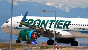 In this June 10, 2020 file photo, a Frontier Airlines jet heads down a runway for take off from Denver International Airport as travelers deal with the effects of the new coronavirus in Denver. (AP Photo/David Zalubowski, File)