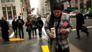 A homeless man begs for money in the Financial District in San Francisco, California March 28, 2012. | REUTERS/Robert Galbraith