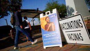 People walk past at a vaccination centre for the coronavirus disease (COVID-19) near the Santa Fe International Bridge, in El Paso, Texas, U.S May 7, 2021. | REUTERS/Jose Luis Gonzalez