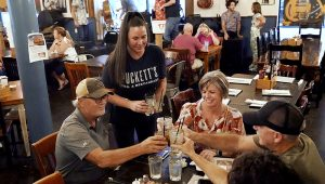 Macy Norman, center, serves a table of guests at Puckett's Grocery and Restaurant. | Mark Humphrey, AP