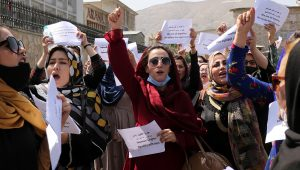 Women gather to demand their rights under the Taliban rule during a protest in Kabul, Afghanistan, Friday, Sept. 3, 2021. As the world watches intently for clues on how the Taliban will govern, their treatment of the media will be a key indicator, along with their policies toward women. (AP Photo/Wali Sabawoon)