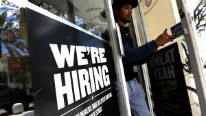 A 'We're hiring' sign in a restaurant window on September 7, 2018 in Miami, Florida. | Joe Raedle/Getty Images