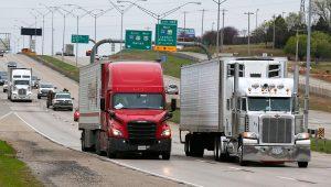 Trucks travel along I-35 in Oklahoma City, Friday, March 20, 2020. (AP Photo/Sue Ogrocki)
