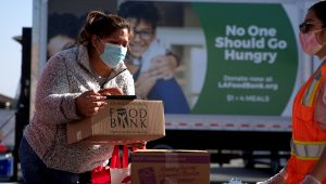 The Los Angeles Regional Food Bank distributes food outside a church in November 2020. | PHOTO: REUTERS/Mike Blake