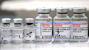 Vials of coronavirus disease (COVID-19) vaccines of Pfizer-BioNTech and Moderna are seen in the town of Ricany near Prague, Czech Republic, February 25, 2021. REUTERS/David W Cerny