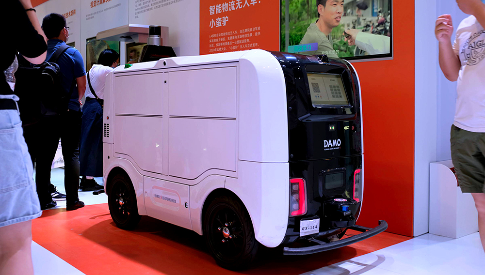 FILE PHOTO: Autonomous delivery vehicle by Damo is displayed at the World Artificial Intelligence Conference in Shanghai. | Reuters